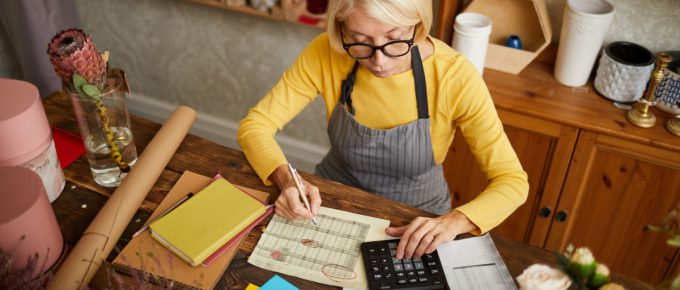 Small business owner does her taxes at her flower shop